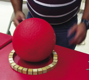 ball surrounded by small wooden cubes during teacher workshop