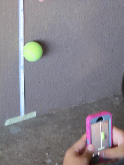 tennis ball bouncing with camera taking a photo of it