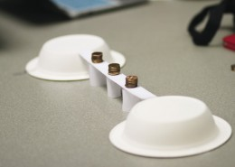 workshop experiment with pennies balancing on paper bridge